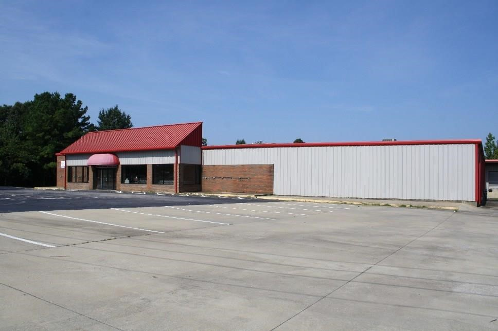 Lender Ordered Auction of Retail Building with Fuel Pumps