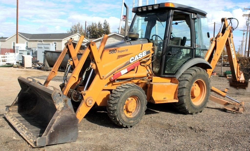 "2001-02 Case 580 Super M Backhoe, 4x4, diesel eng, cab, extend-a-hoe, 24"" backhoe bucket, 3730 hrs. SN: JJGO283373.  Note: The Town of Bennett uses this unit at the cemetery, and there is a good possibility it will be used between now and day of auction, and a few more hrs might be added. On 12-29-17 a new hyd pump was put in and hyd issues were rectified along with a 1000 hr service check-up (view 1)"