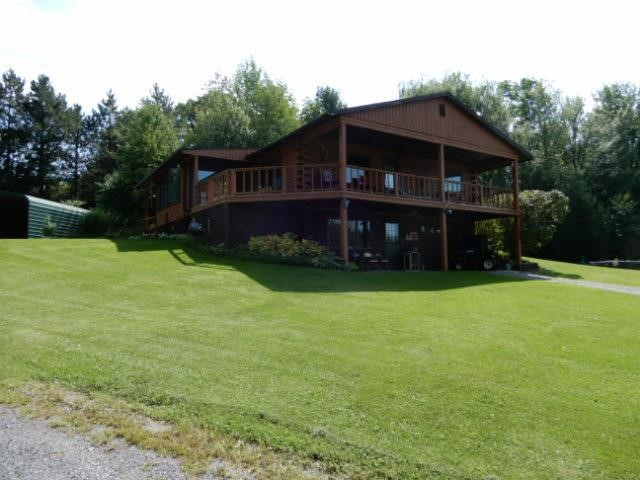 Log Cabin Home W/Pond Setting on 8.32 Acres
