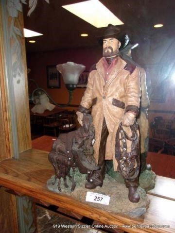 COWBOY FIGURINE ON SHELF IN 2ND DINING AREA