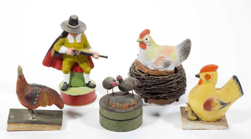 Good selection of antique/vintage candy containers and squeak toys