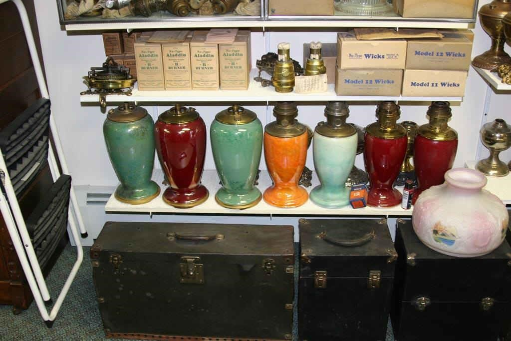 Tom Small collection showing a wide variety of Aladdin vase lamps.