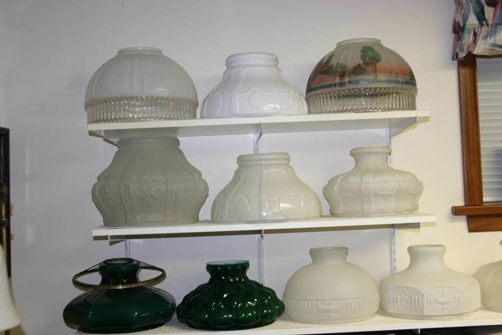 Tom Small collection showing a variety of Aladdin lamp shades.