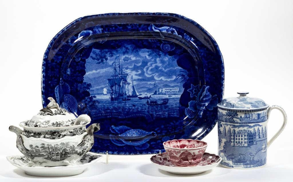 "Fine forms and patterns of English transfer-printed ceramics including a large platter having the design ""Cape Coast Castle on the Gold Coast of Africa"" and Henshall and Company's sauce tureen and undertray having ""Gothic Scenery"" design."
