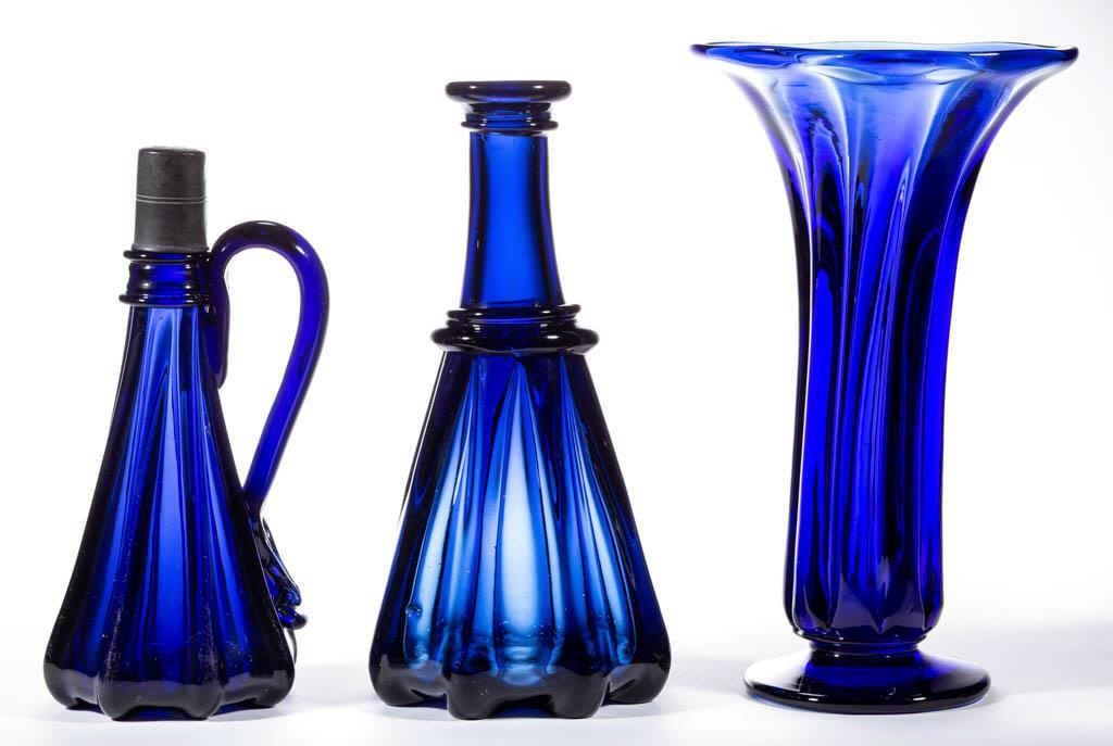 Variety of pillar-molded wares including: Molasses jug, Decanters, and a vase.