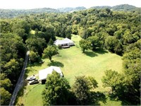TWO HOMES ON 70+/- ACRES